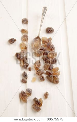 Brown Candy Sugar On White Wood