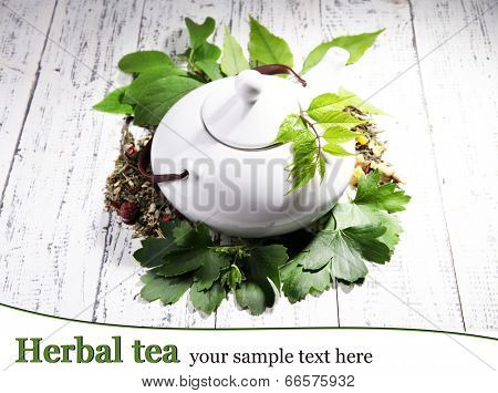 Herbal natural tea with dry flowers and herbs ingredients, on color wooden background