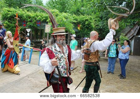 MUSKOGEE, OK - MAY 24: Actors in historical costumes greet visitors during the parade at the Oklahoma 19th annual Renaissance Festival on May 24, 2014 at the Castle of Muskogee in Muskogee, OK