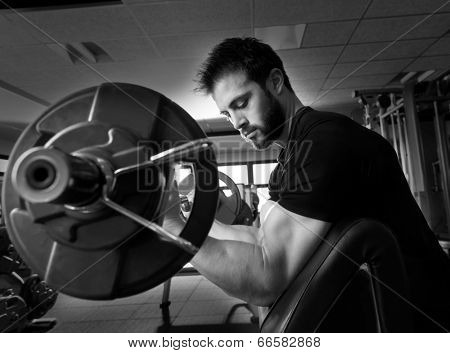 biceps preacher bench arm curl workout man at fitness gym