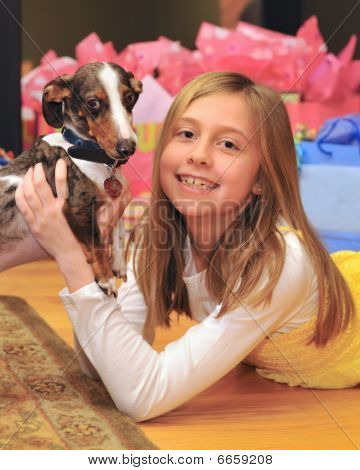 Young girl and dog celebrate at party