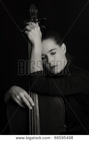 Beautiful Brunette Holding Cello With Selective Light In Red Dress Artistic Conversion