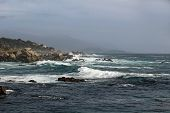 stock photo of pch  - Rocky waters and crashing waves at Pebble Beach - JPG