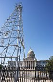 image of derrick  - Oklahoma capital building showing oil derrick in front of building - JPG