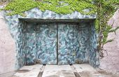 foto of camoflage  - Camoflaged bunker doors in cement covered with climbing ivy - JPG