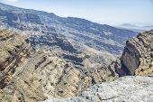 stock photo of jabal  - Image of canyon on mountain Jebel Shams in Oman - JPG