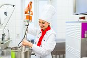 image of food processor  - Female Chef preparing ice cream with food processor in gastronomy parlor kitchen - JPG
