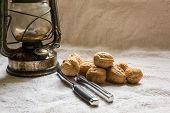 stock photo of nutcrackers  - Set with some walnuts a nutcracker and a lantern - JPG
