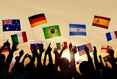 stock photo of japanese flag  - Silhouettes of People Holding Flags From Various Countries - JPG