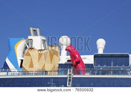 Royal Caribbean Cruise Ship Quantum of the Seas with statue of the Magenta Polar Bear