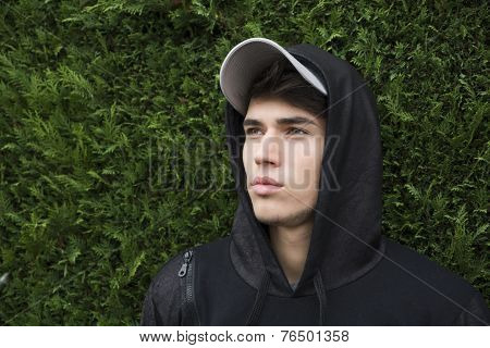 Attractive Young Man With Hoodie And Baseball Cap