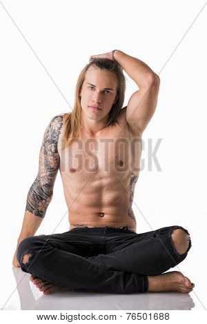 Beautiful Young Long Haired Man Shirtless, Sitting On The Floor