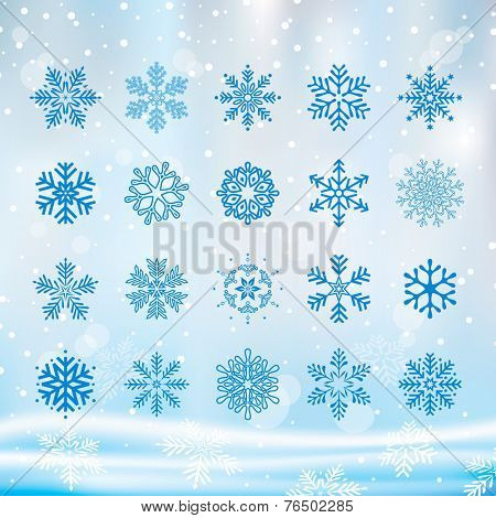 Various Christmas snowflakes set with winter background.