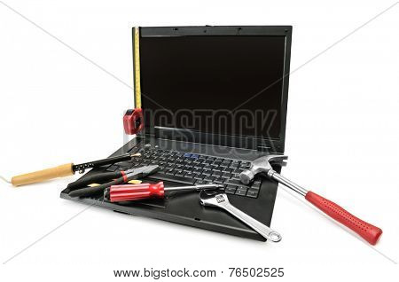 Computer repair with set of tools.