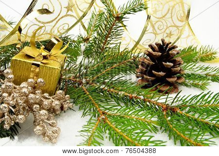 Golden Christmas Gifts With Golden Ribbon And Needles Fir With R