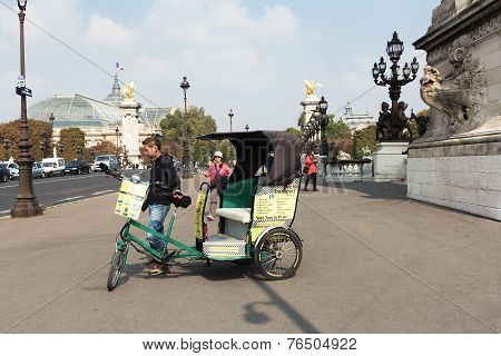Bicycle taxi carries tourists for sightseeing.