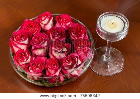 Red Rosebuds In Glass Vase