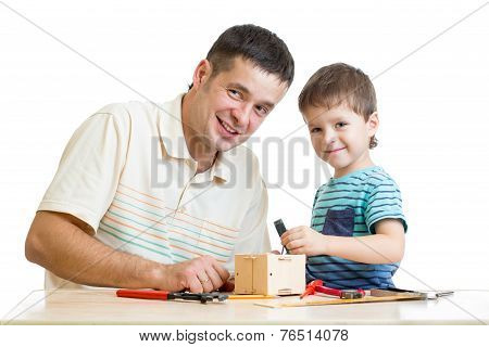 Father and son kid tinkering nesting box