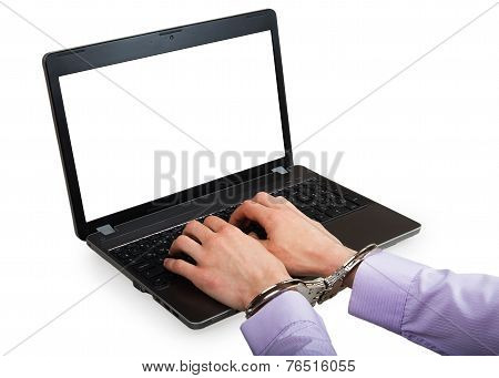 Hands In Handcuffs On A Laptop With White Screen