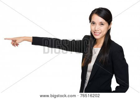 Business woman pointing aside