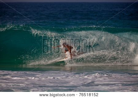 Surfer Riding