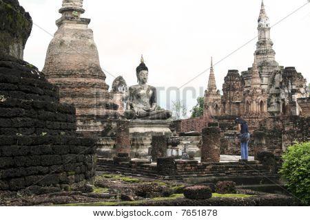 Thai Woman Praying Sukothai Buddha