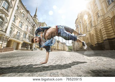 Hip hop dancer is dancing