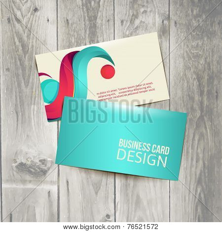 Business card on the wooden table.