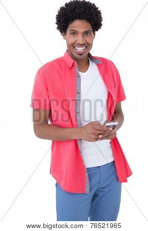 Happy causal man holding smartphone on white background
