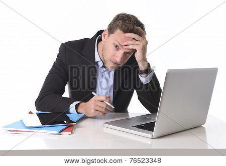 Attractive Businessman Working In Stress At Office Desk Computer Suffering Headache