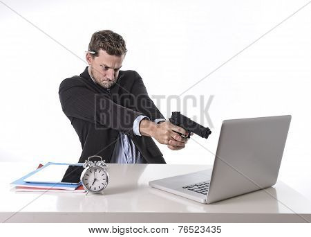 Businessman Pointing Gun To Computer In Overwork And Overtime Work Concept