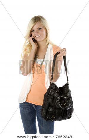Girl Orange Shirt And Purse On Phone