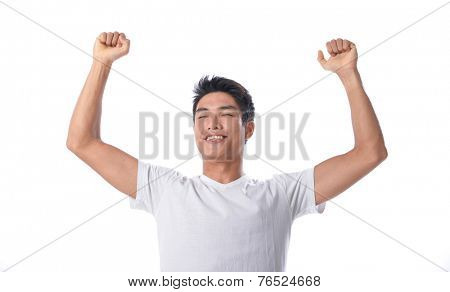 Successful young man with arms up