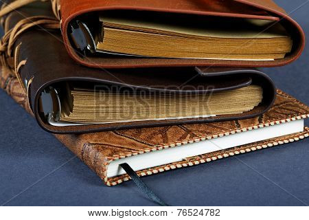 Pile Of Notebooks In Leather Covers Close Up