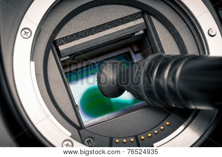 Image Photo Sensor Being Cleaned With A Lens Pen.