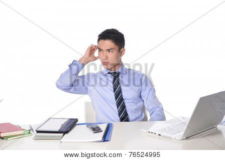 Young businessman having problems with his laptop