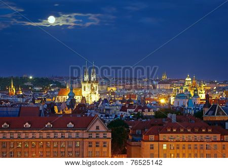 Prague cityscape at night time with full moon