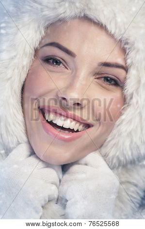 Woman Wearing A White Fur Cap
