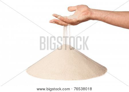 sand running through hand as a symbol for time running out. Isolated on a white background