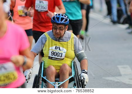 Senior Man In A Wheel Chair Racing