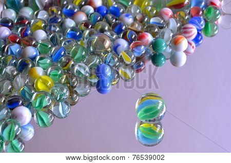 Multi Coloured Glass Marbles on Mirror