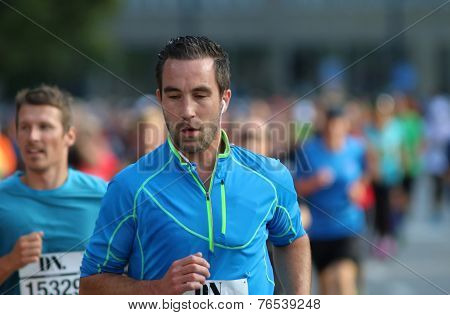 Focused Caucasian Man Running