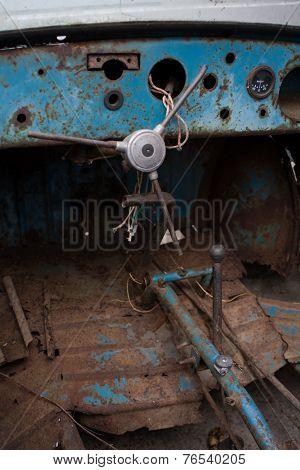 Inside the rusty car.