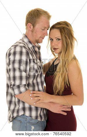 Man Plaid Shirt Arms Around Woman Looking