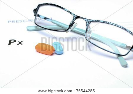 Empty Medical Prescription With Glasses And Pills Above