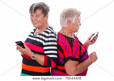 Two Senior Women Communicating With Cellphones