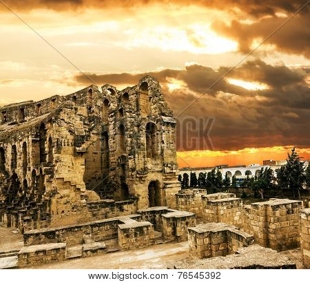 Roman Amphitheatre In The City Of El Jem In Tunisia Amid Colorfull Sunset