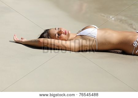 Sunbather Woman Showing Laser Hair Removal Armpit On The Beach