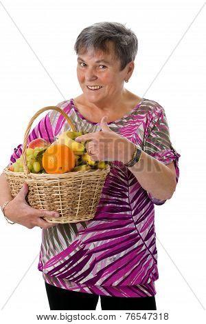 Senior Woman Presenting Fruit