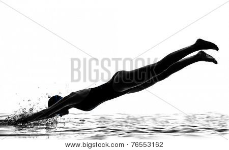 one  woman competition swimmer on starting in silhouette studio isolated on white background
